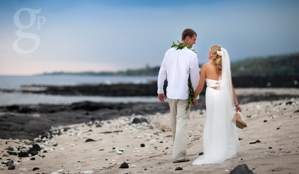 Wedding couple walking on the beach