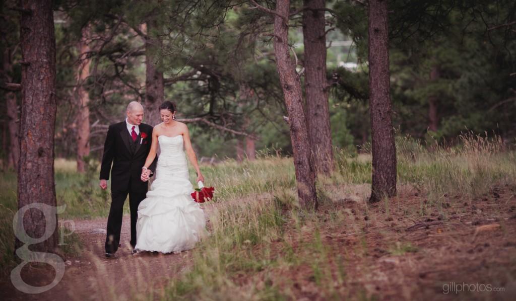 Wedding couple walking on mountain trail