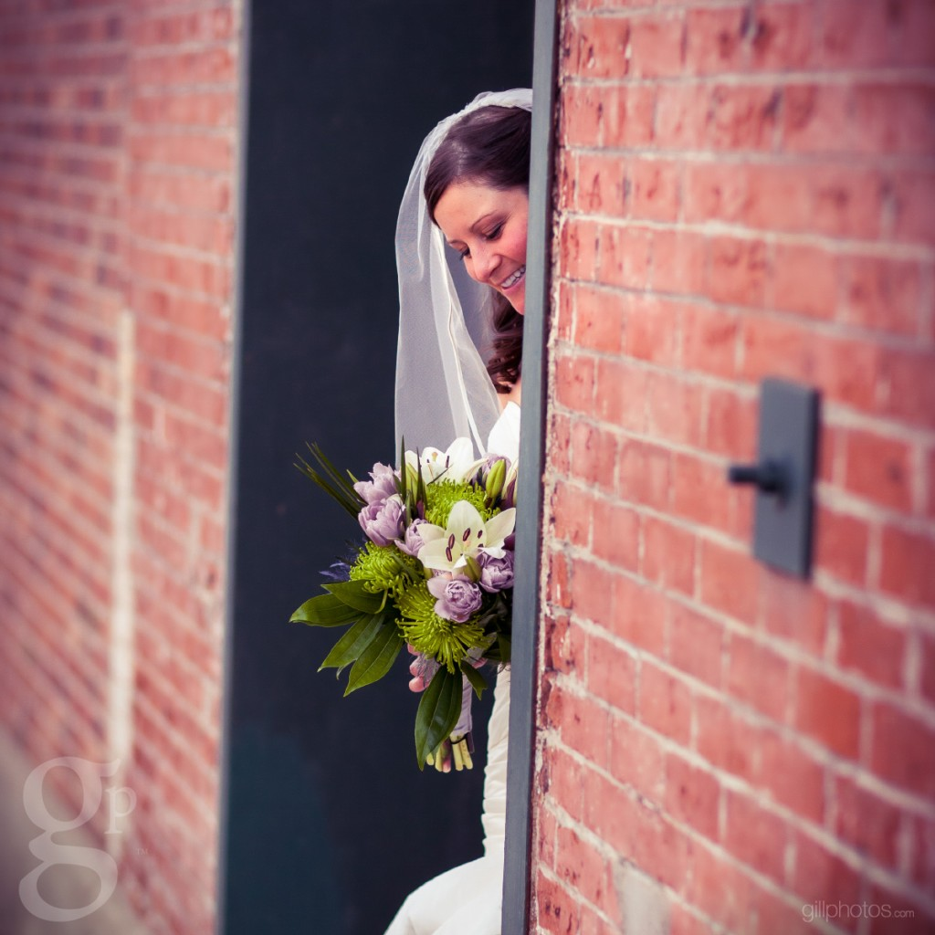 Bride looks at her flowers