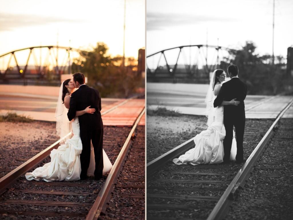 Bride and groom on train tracks