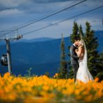 Bride and Groom in field of Wildflowers at Aspen Wedding Deck in Aspen, CO