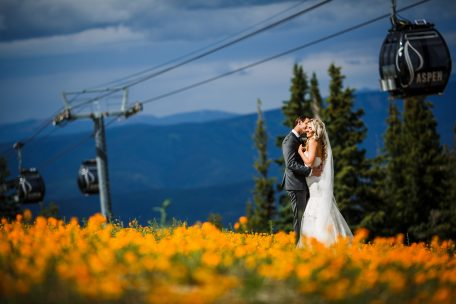 Bride & Groom in field of Wildflowers at Aspen Wedding Deck in Aspen, CO