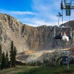 Couple rides chairlift at A Basin, CO