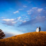 Sanctuary Wedding - Bride and Groom on hill in Sedalia, CO
