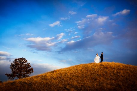 Sanctuary Wedding - Bride and Groom on hill in Sedalia, CO
