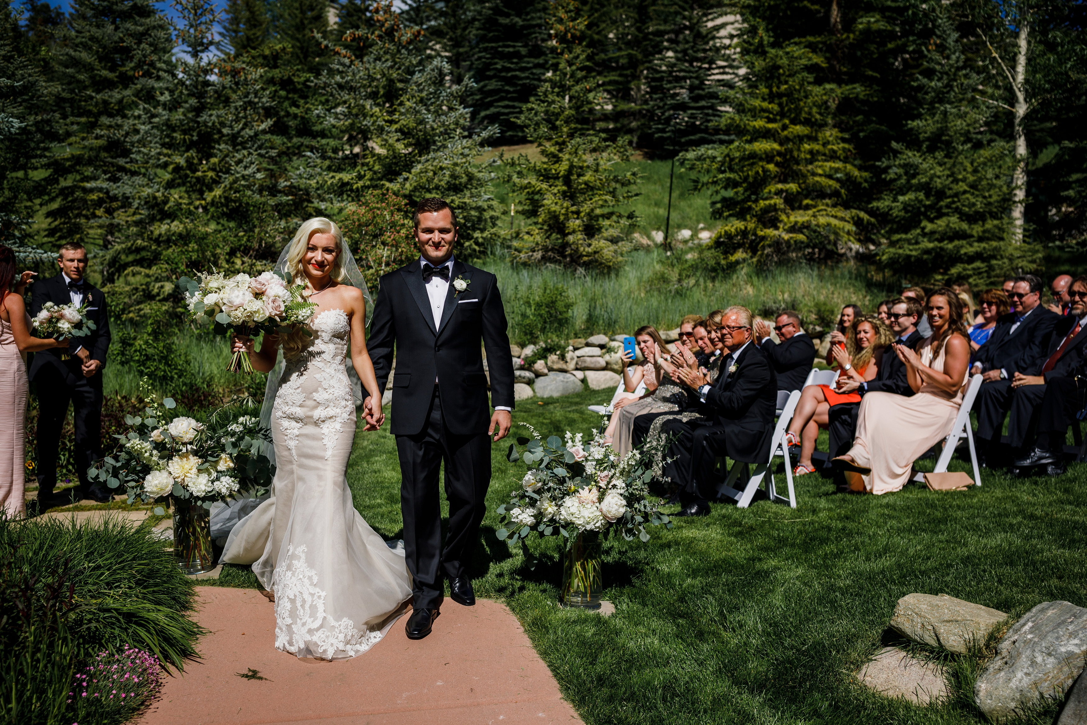 Bride & groom recessional at Park Hyatt Wedding Garden
