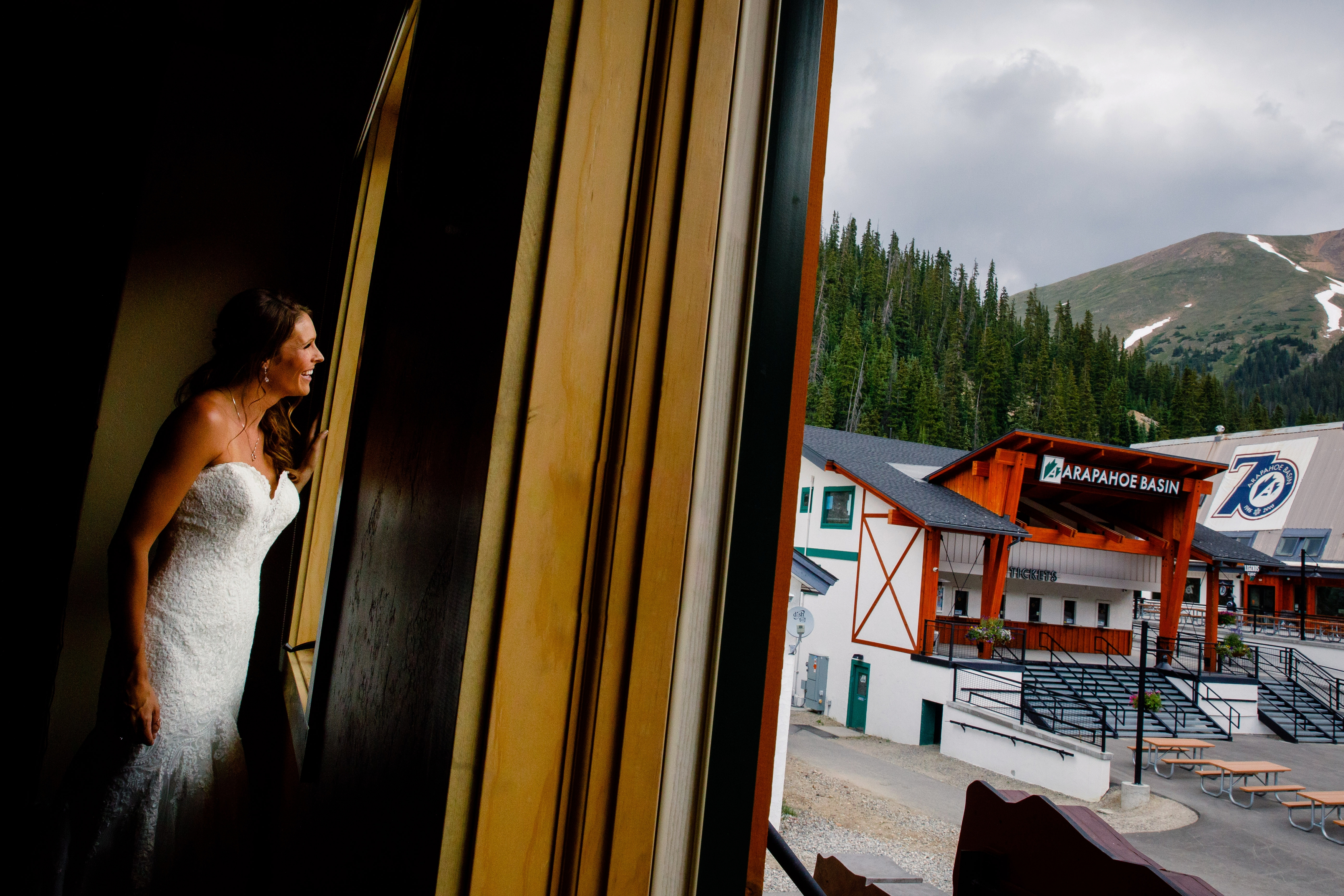 Arapahoe Basin Wedding Bride looking at rain clouds