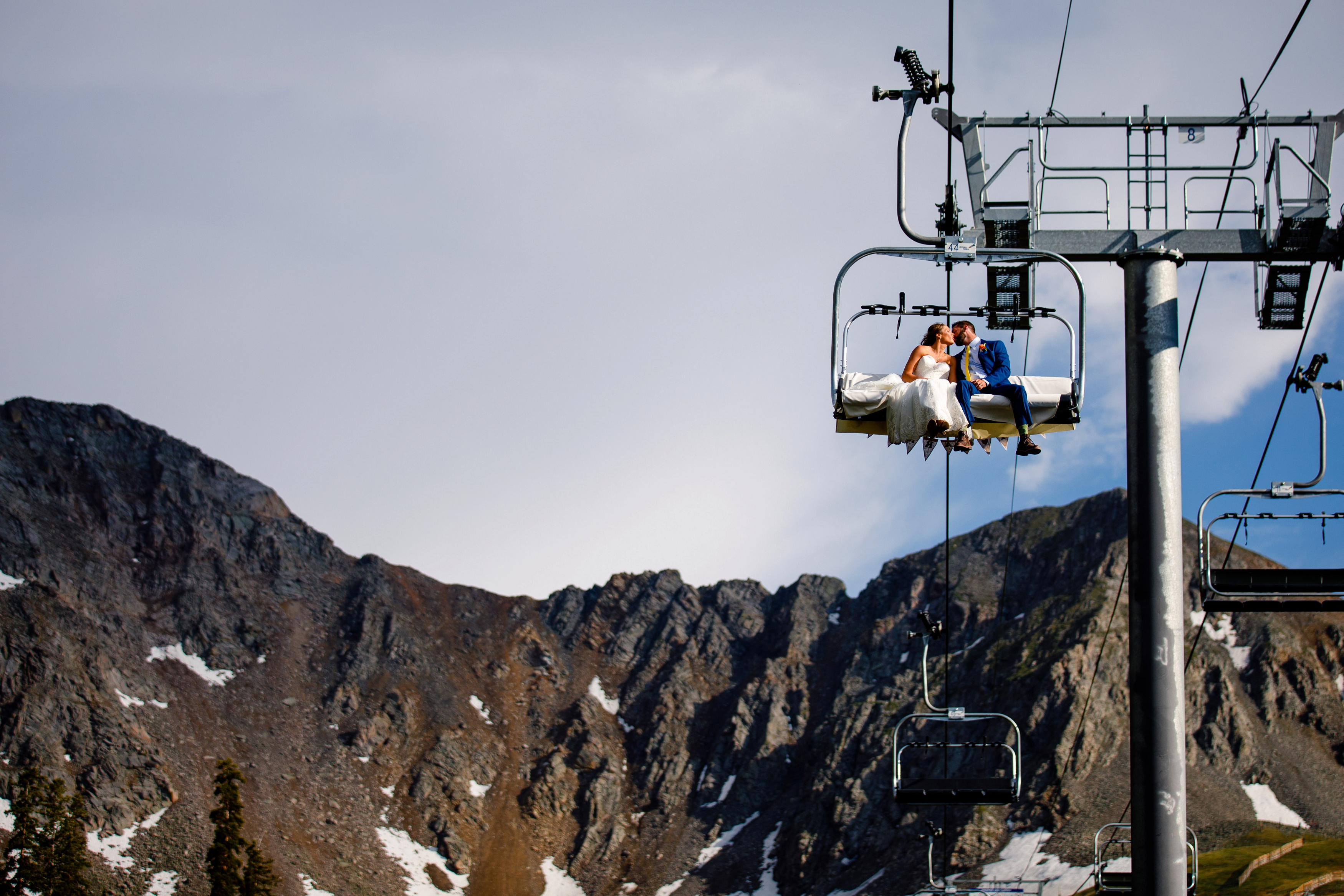 Bride & groom ride the chairlift down at Arapahoe Basin Wedding in Keystone, CO