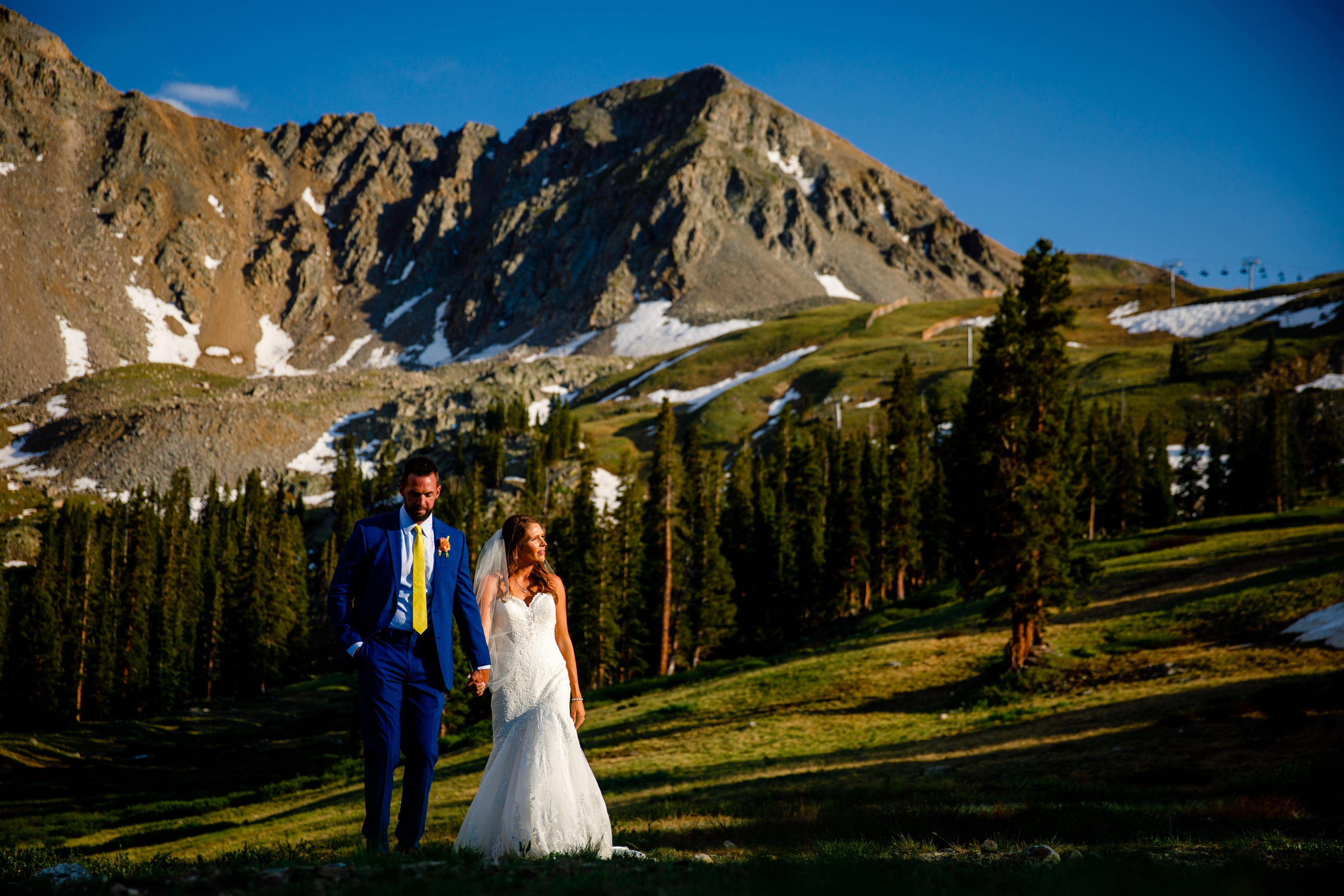 Arapahoe Basin Summer Wedding Photo of bride & groom walking