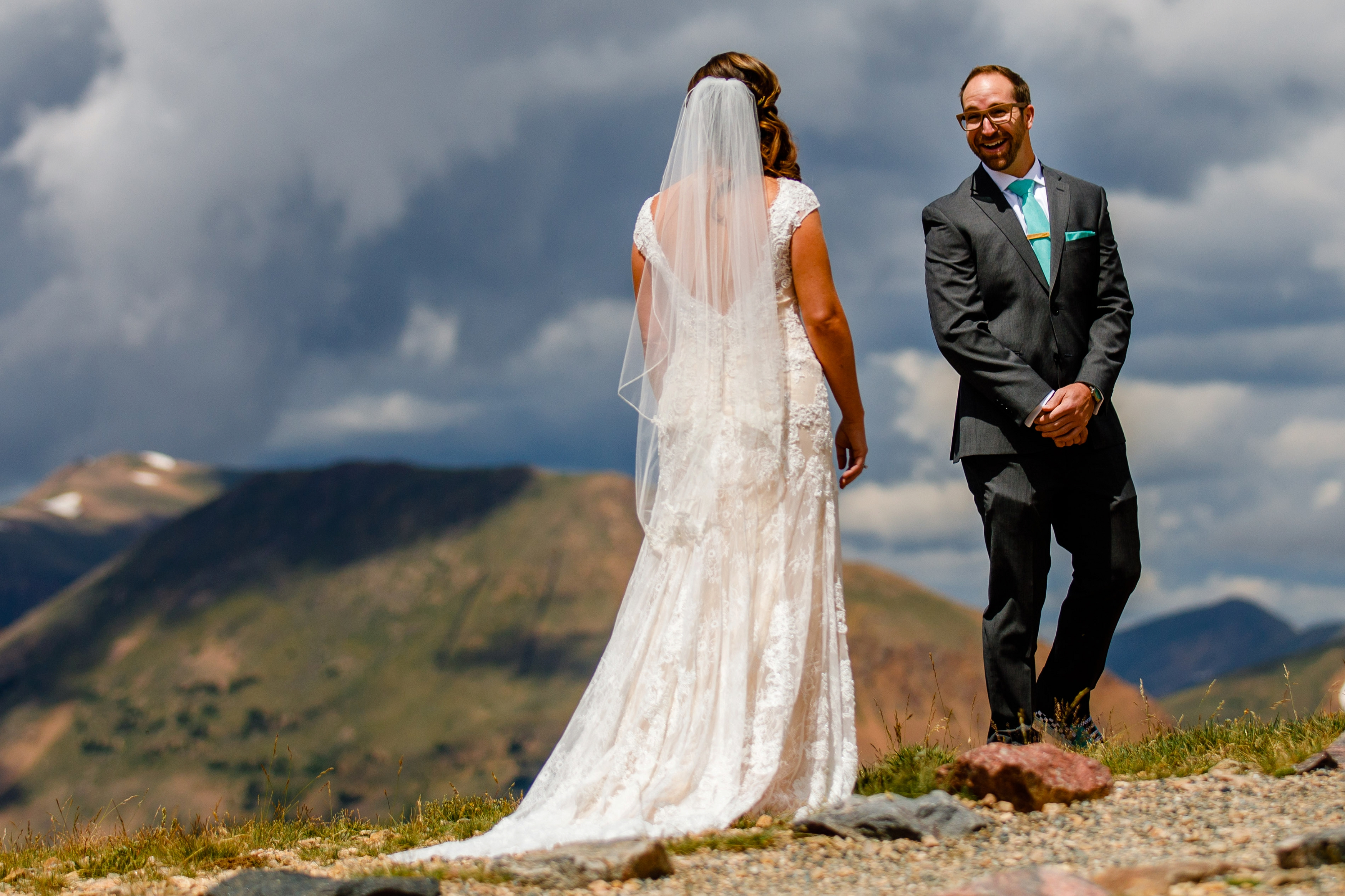 Bride & groom's first look on top of Loveland Pass before their Black Mountain Lodge Wedding