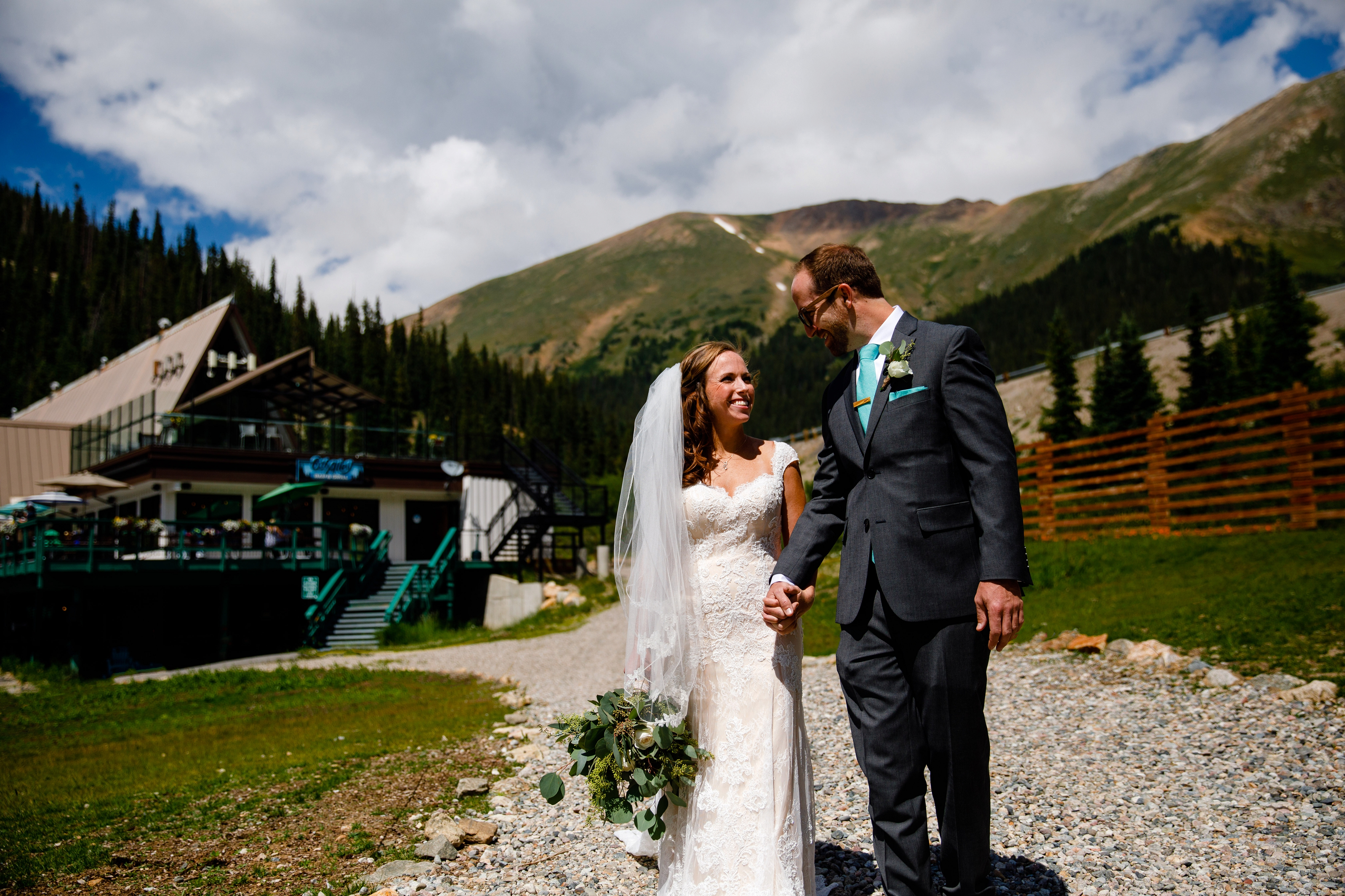 Married couple walking the ski runs at Arapahoe Basin before their wedding.