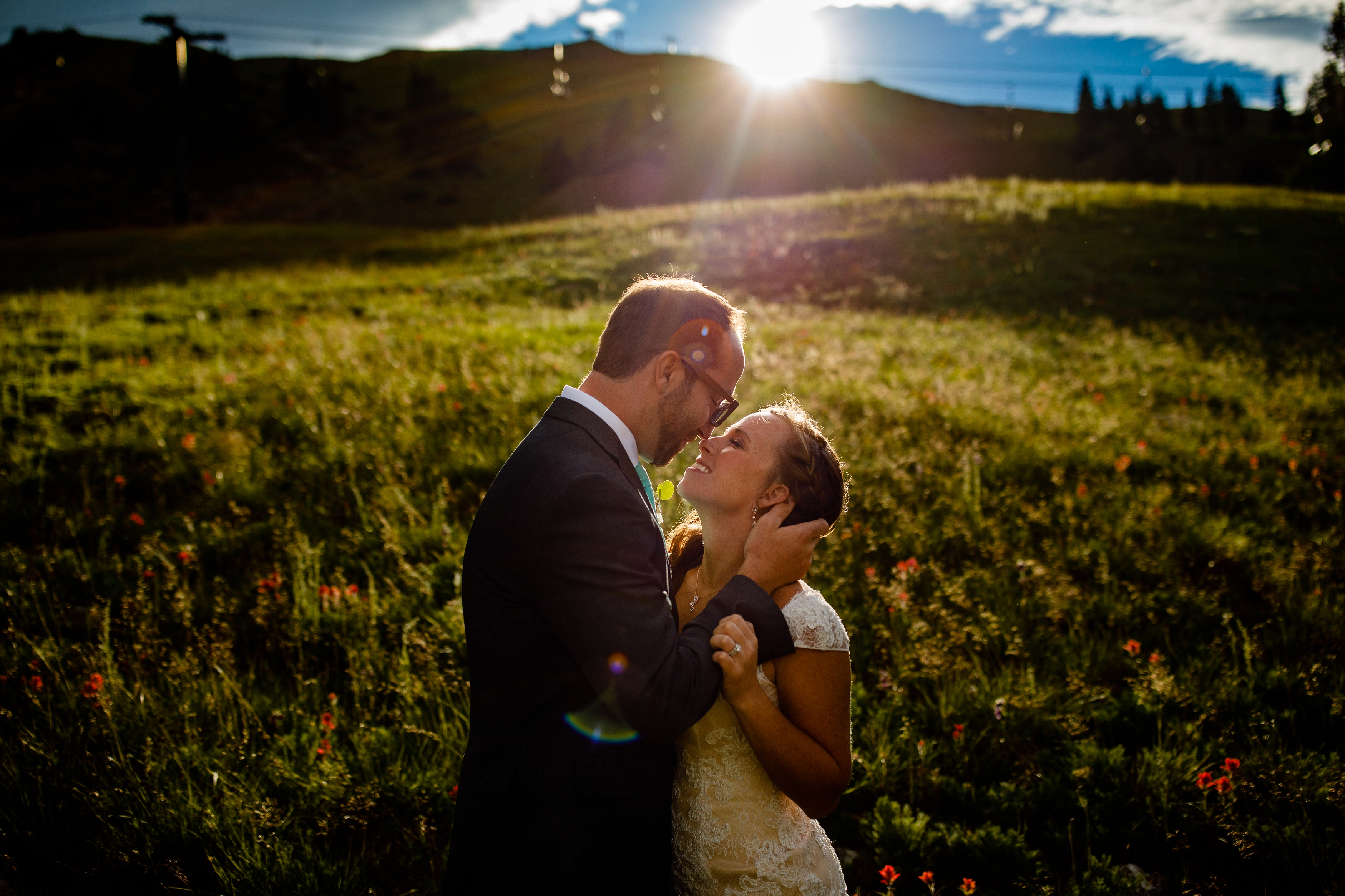 Sun drenched portrait of bride & groom after their wedding ceremony.