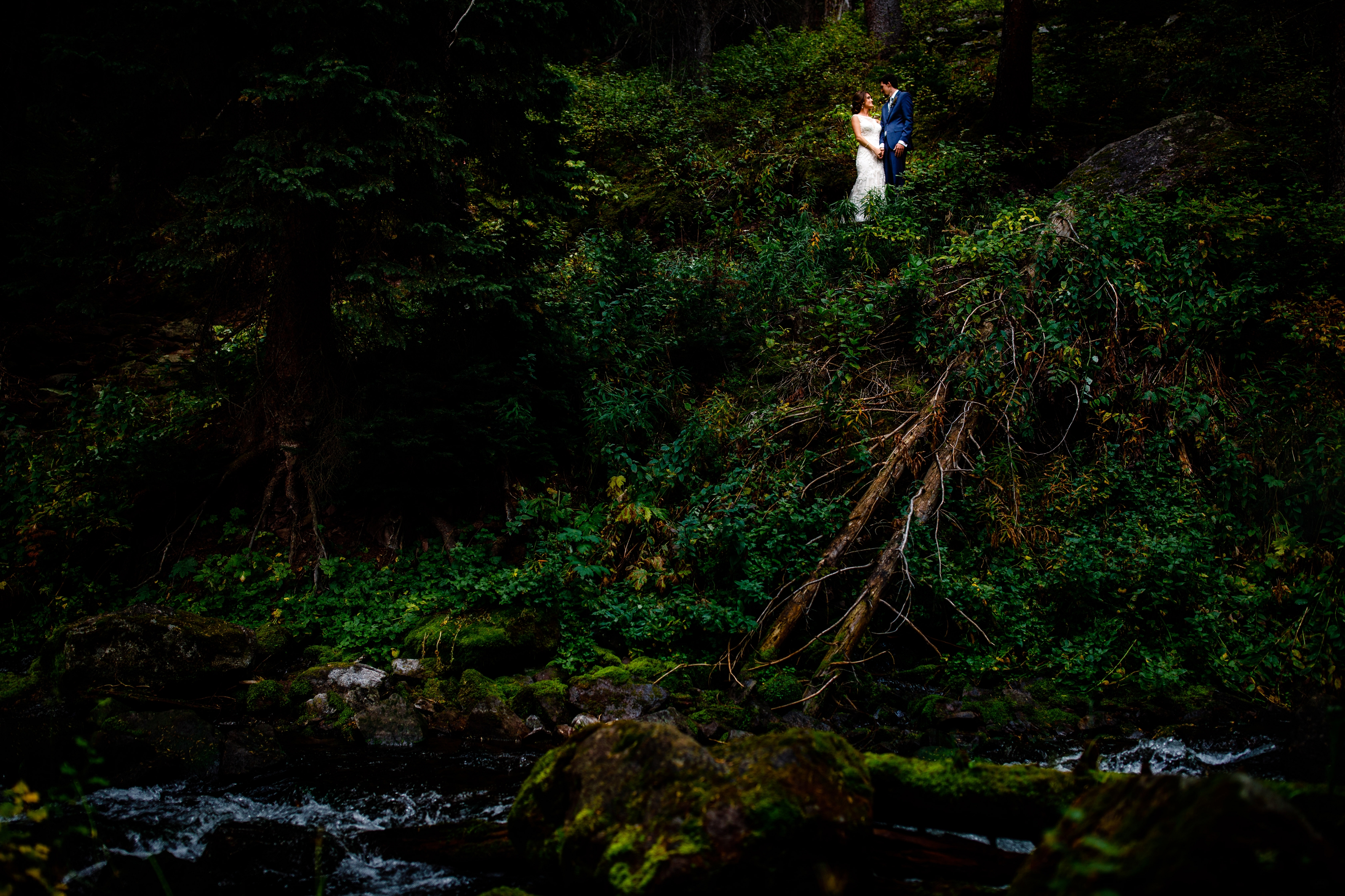 A bride & groom see each other for the first time next to Maroon Creek.