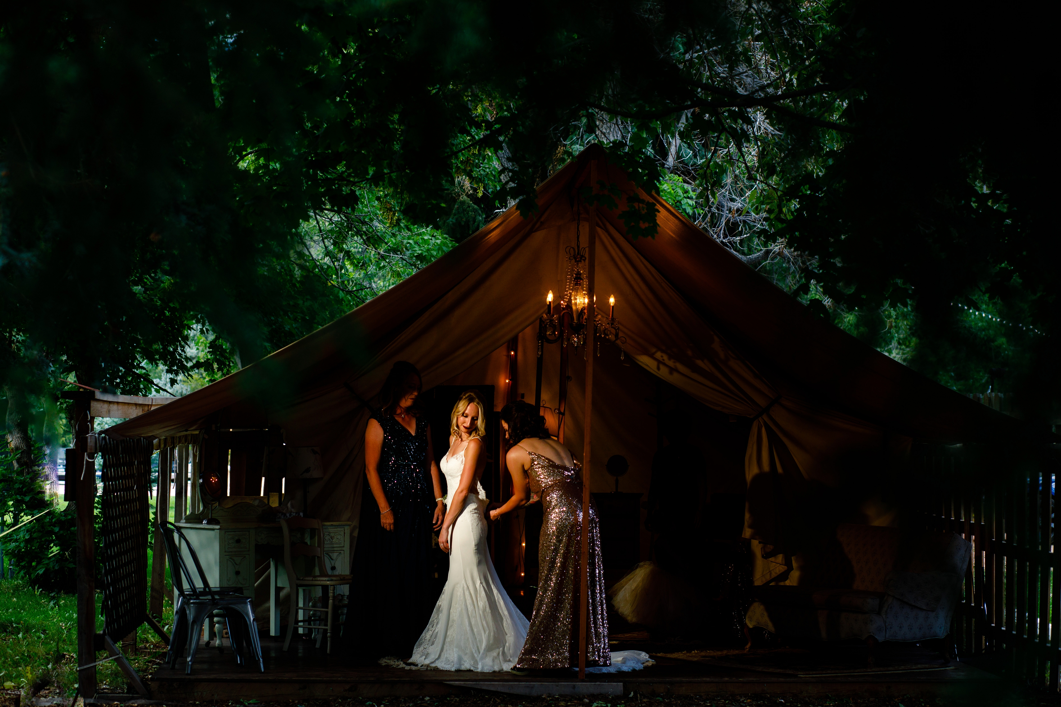 Bride getting ready in the tent at the River Bend venue in Lyons, CO