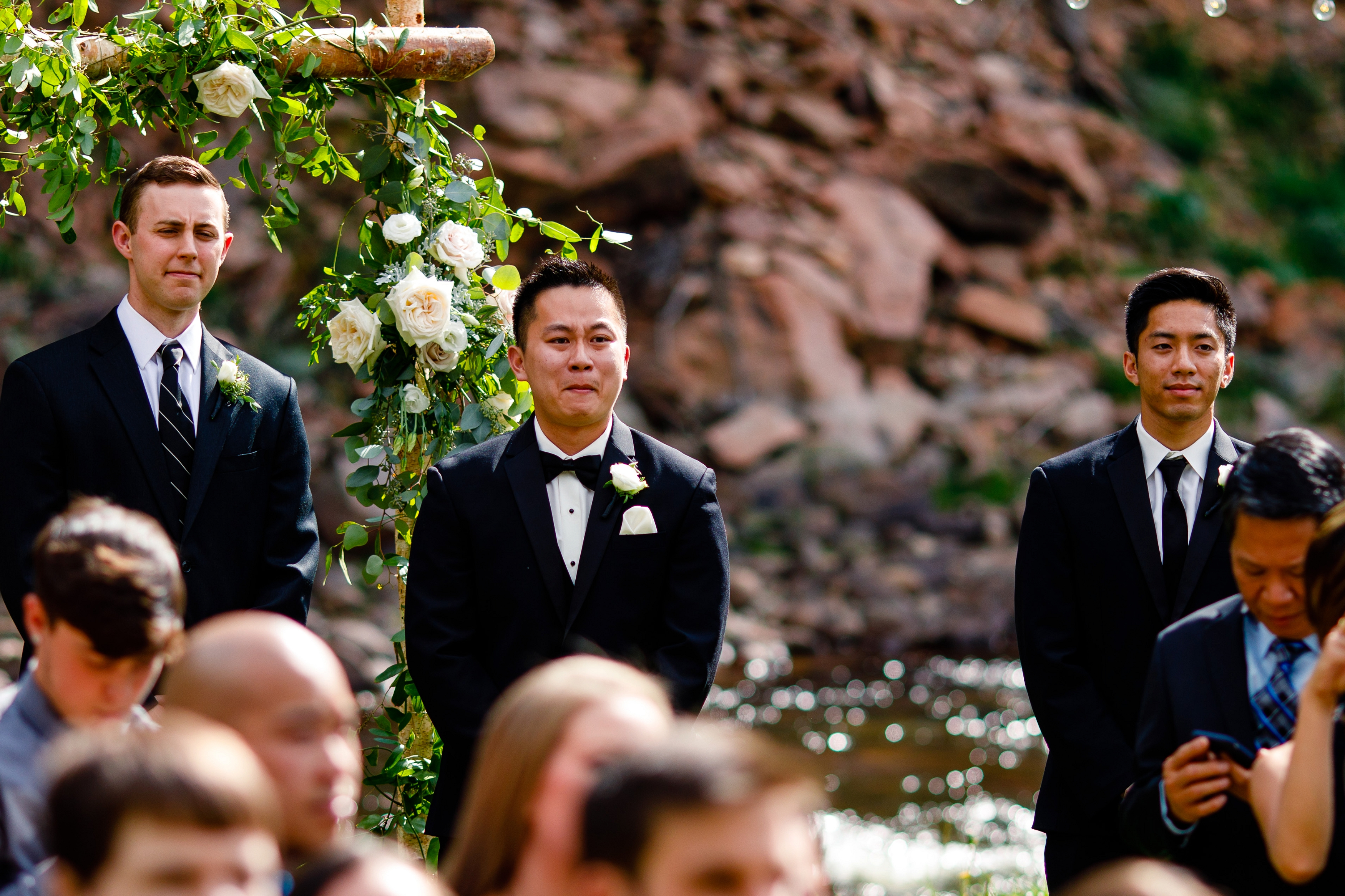 Groom reacting to the bride coming down the isle for this River Bend Wedding