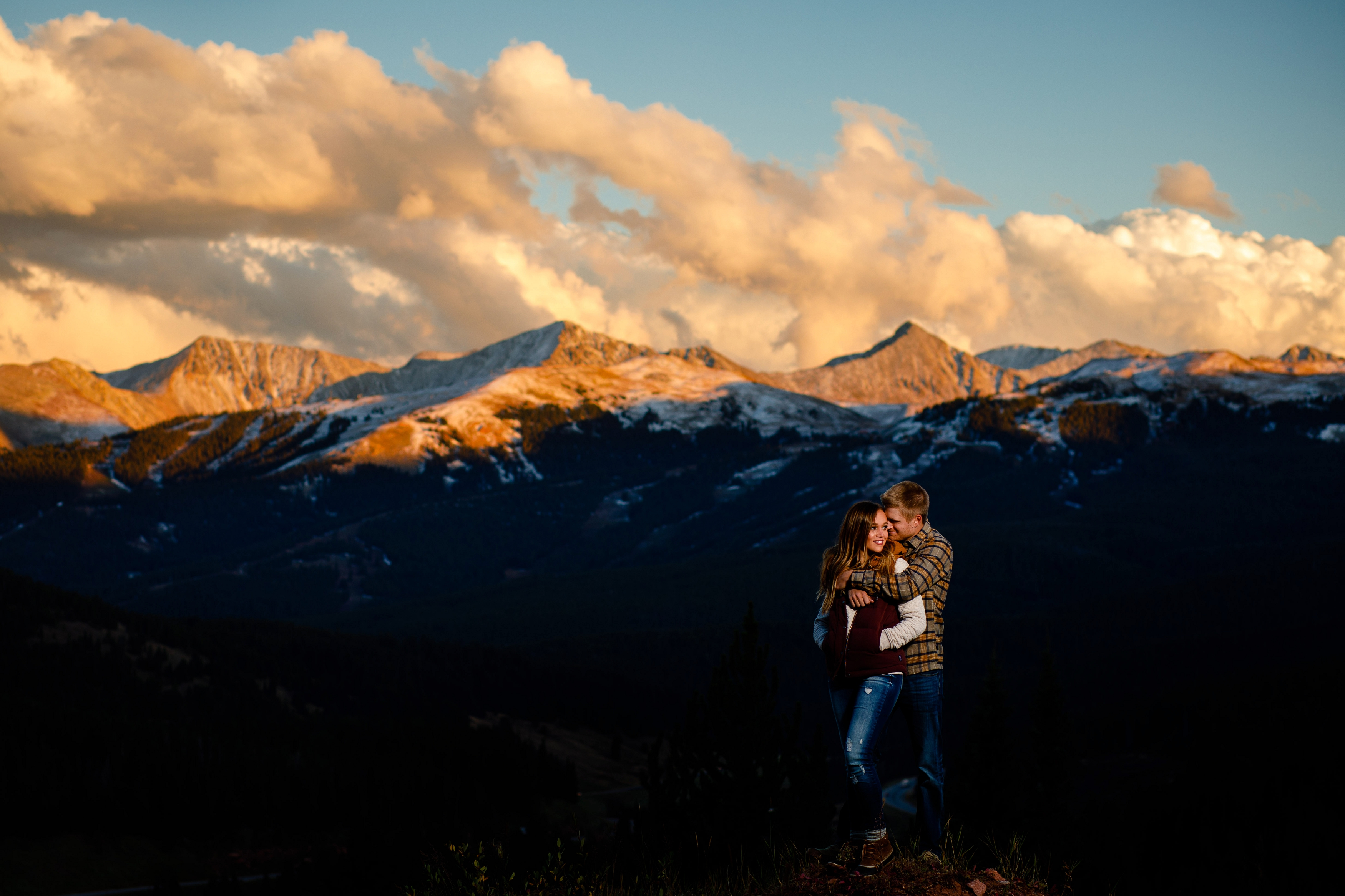 On top of Shrine Pass with Copper Mountain in the background during their Colorado Engagement Photo Session.