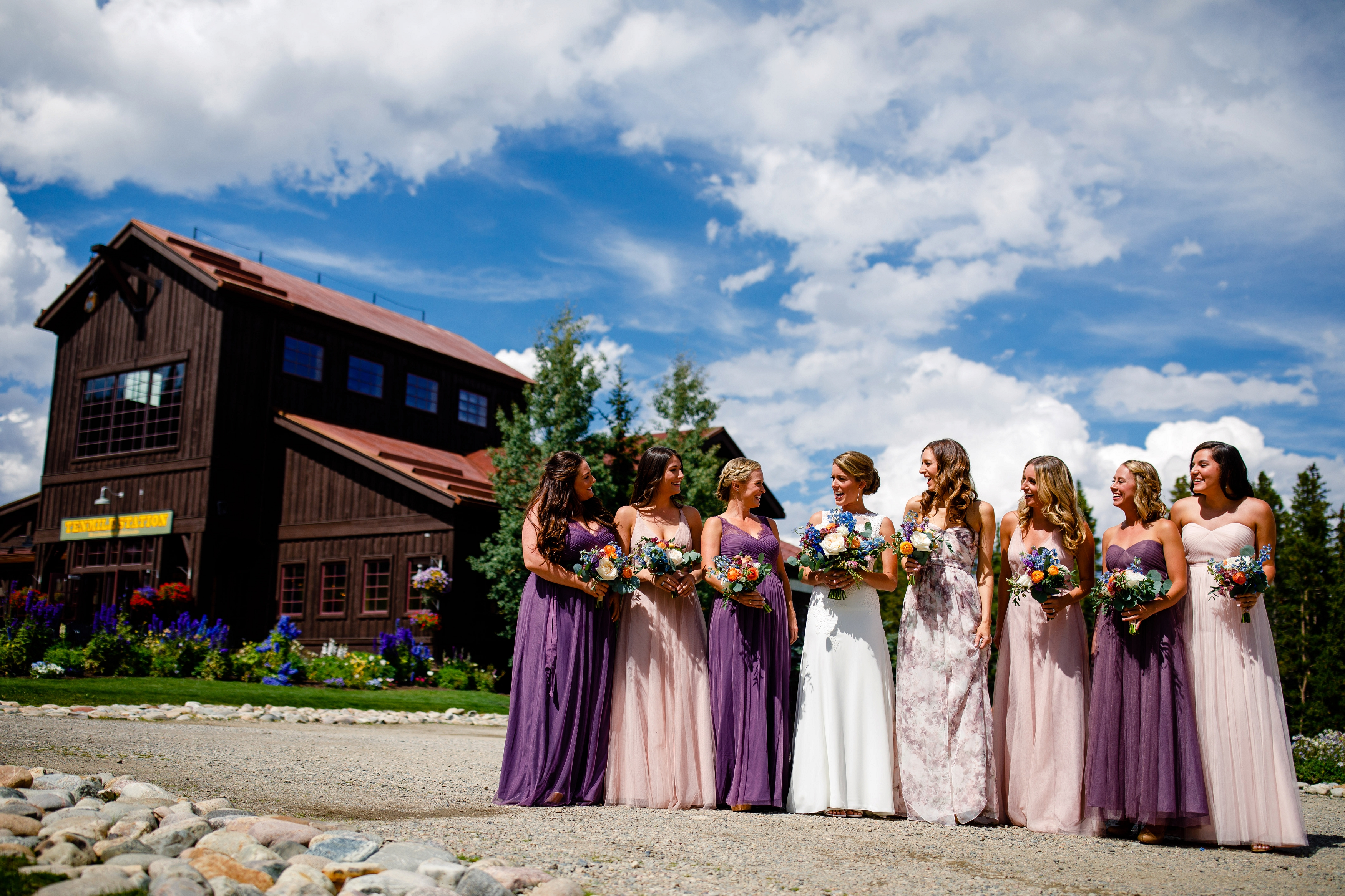 Bridesmaids and their beautiful bouquets at TenMile Station before Lauren & Nicks Breckenridge Wedding