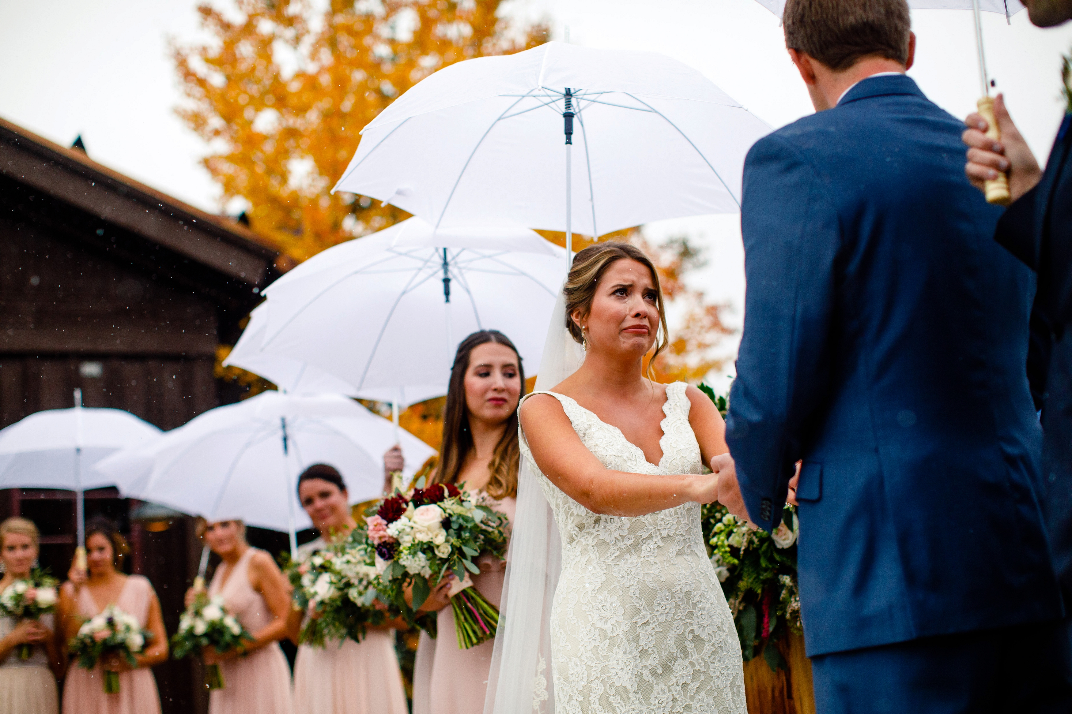A bride cries during her ceremony at Tenmile Station in Breckenridge, CO.