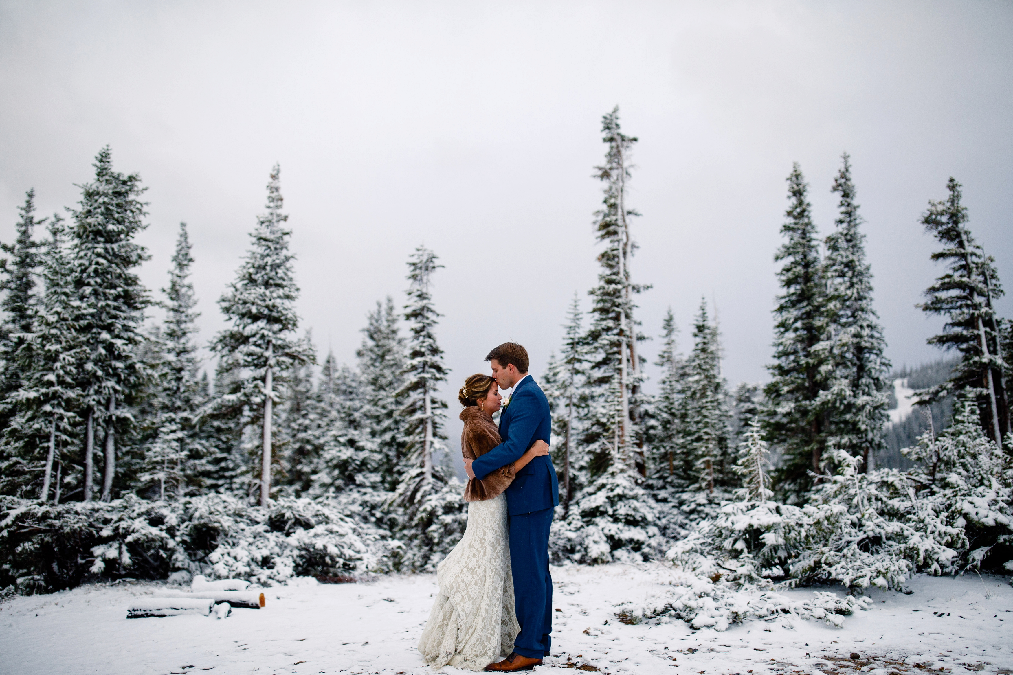 Up above the storm for wedding portraits during their Tenmile Station Fall Wedding.
