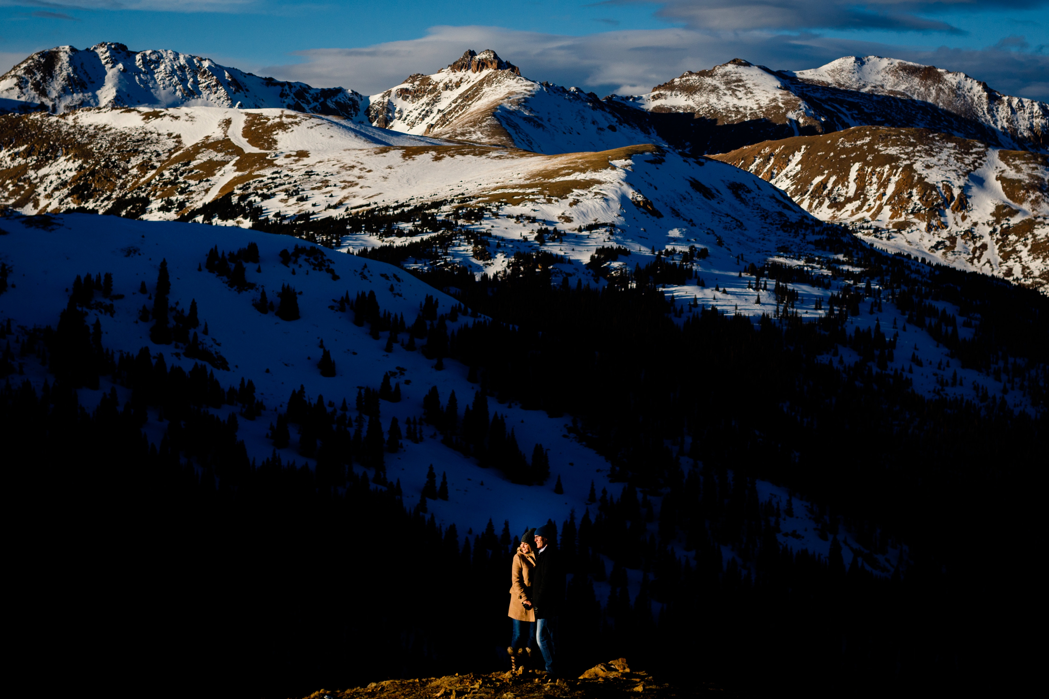 A beautifully sunlit engagement photo on top of Loveland Pass near Keystone, CO.