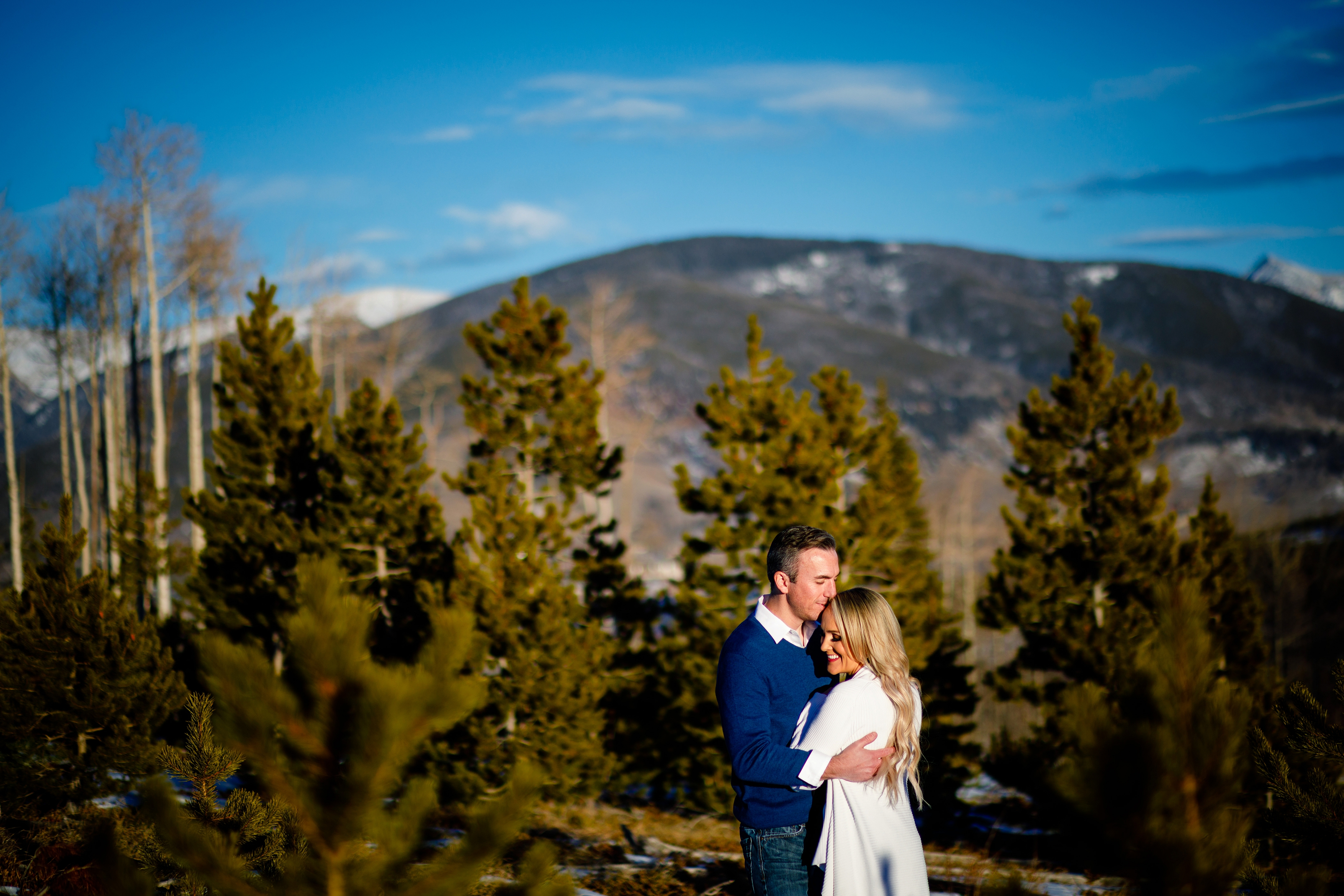 Beautiful couple posing in the warm sun during their engagement photo session in Silverthorne, CO.