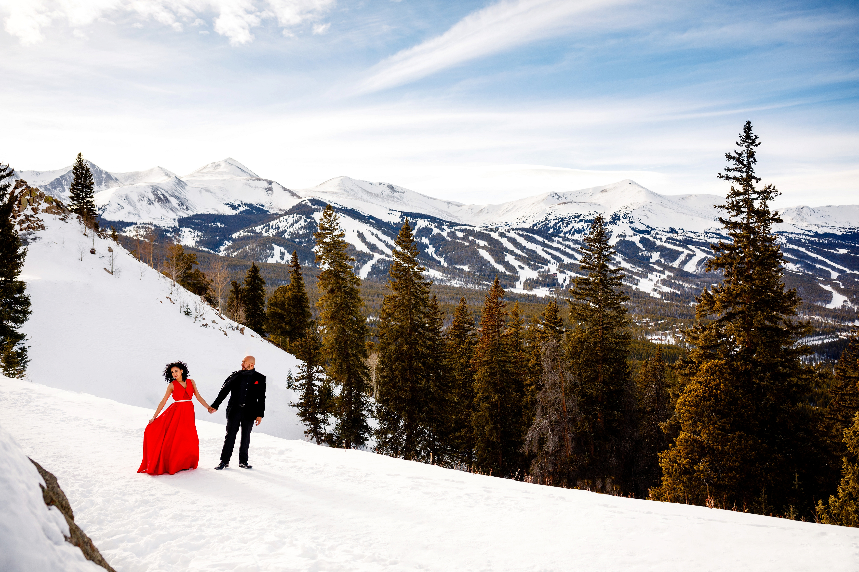A beautiful couple strolls along Boreas Pass during their Winter Engagement session in Breckenridge.