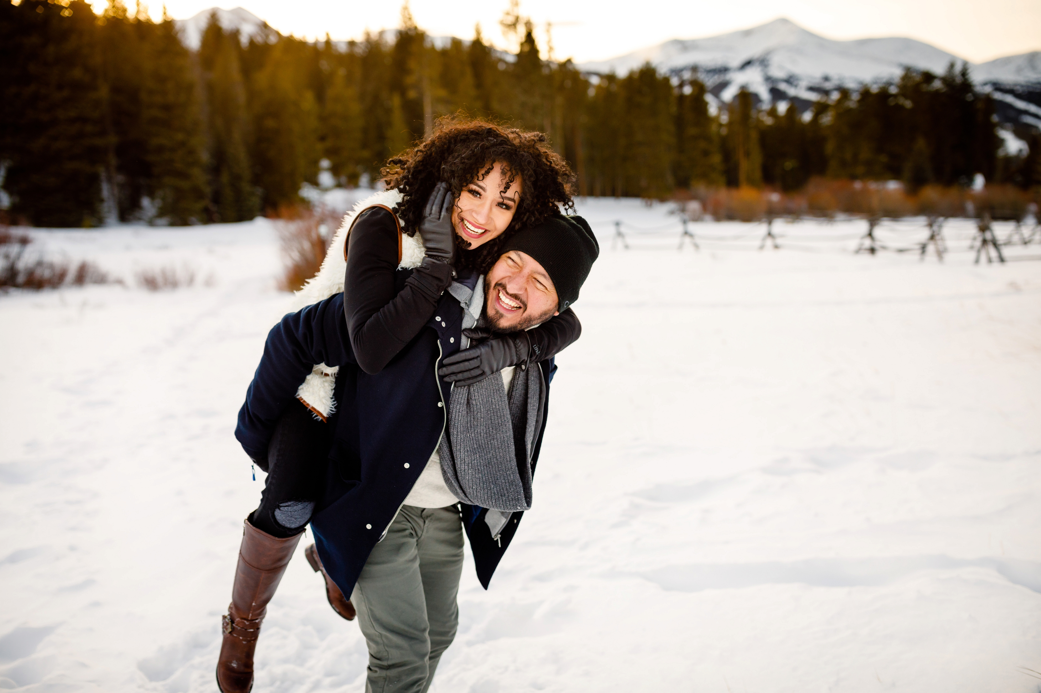 Robert gives Elizabeth a piggyback during their Boreas Pass Winter Engagement in Breckenridge.