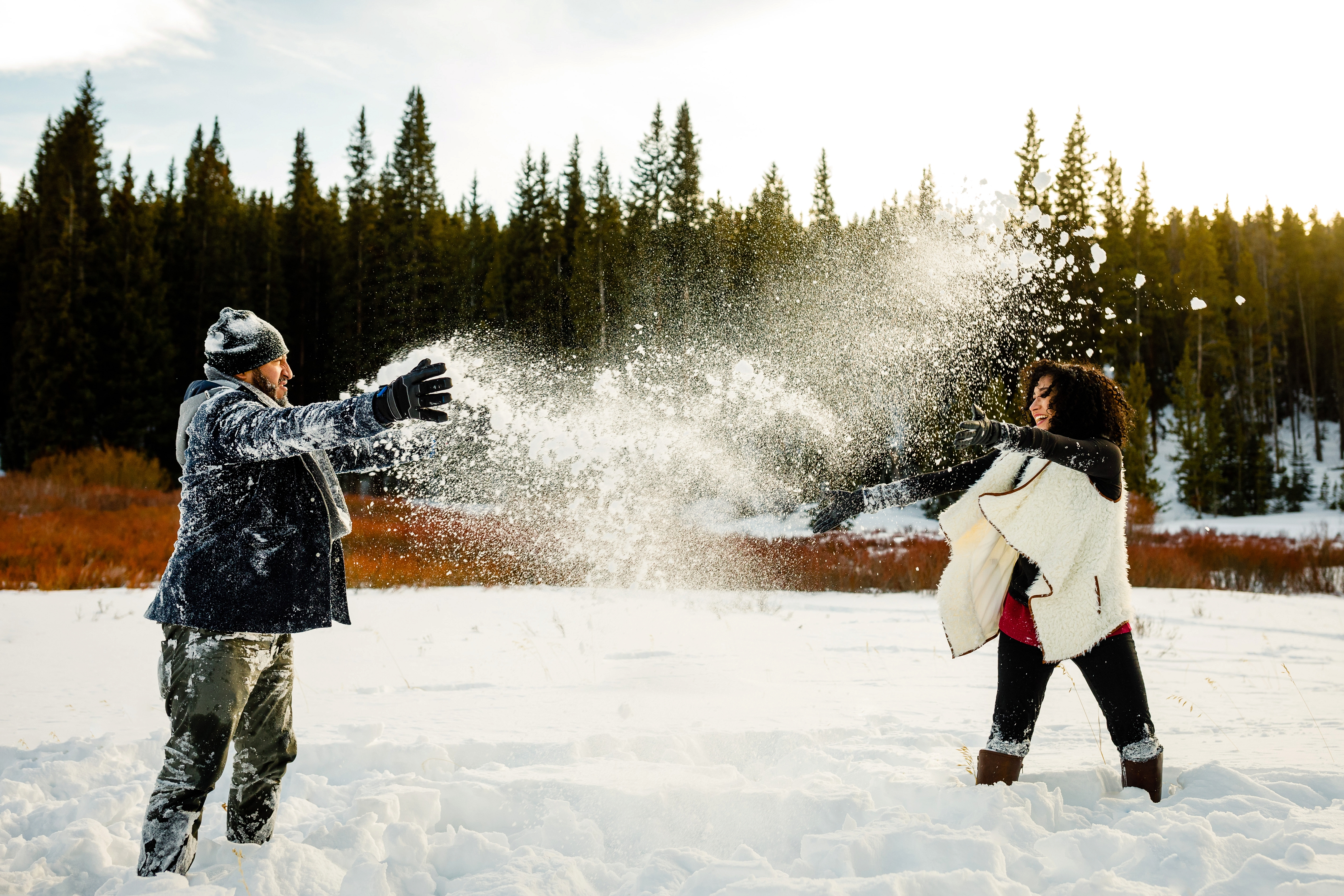 A snowball fight during engagement photos near Boreas Pass.
