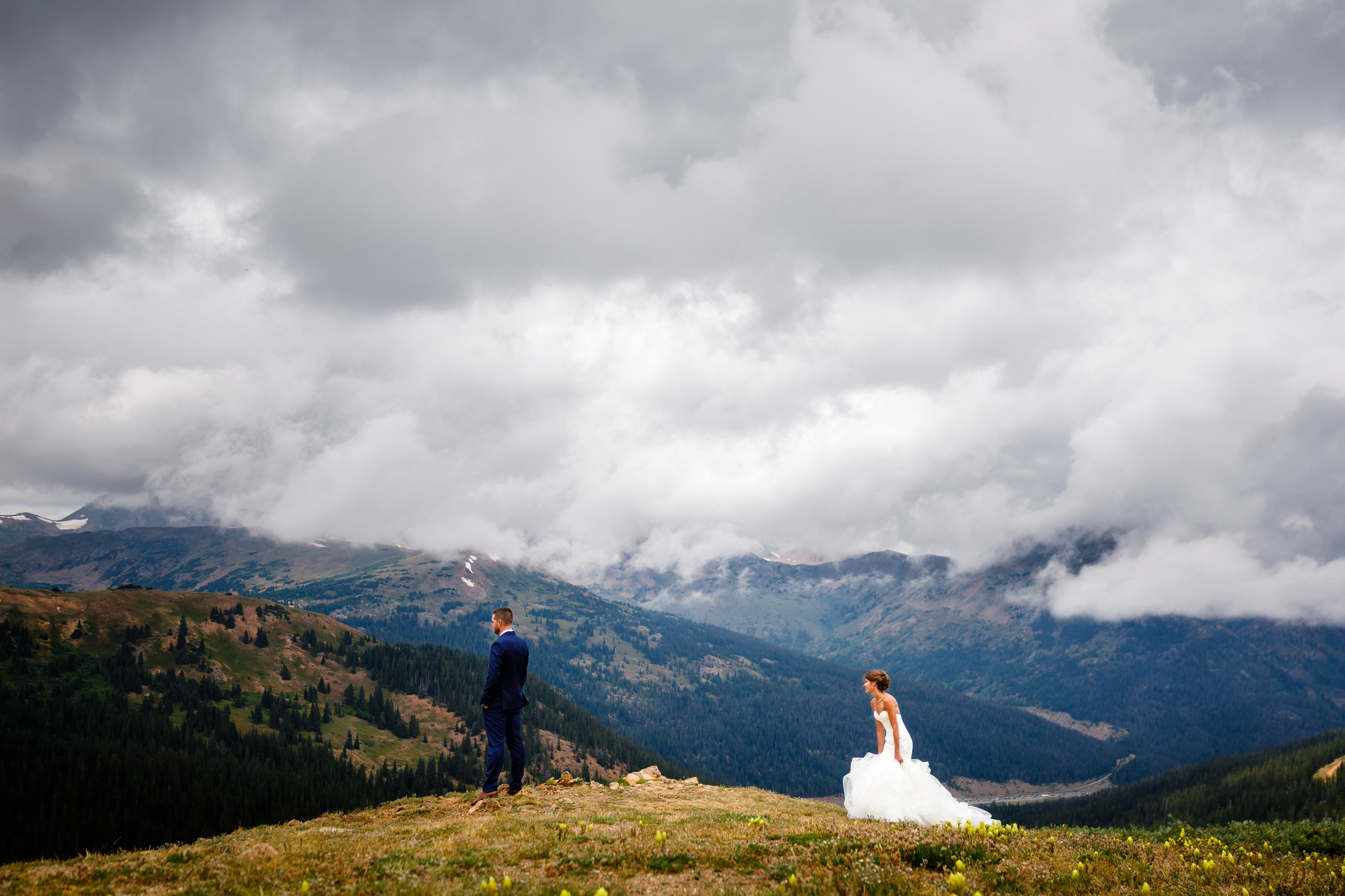 A bride and groom for their first look on top of Loveland Pass.