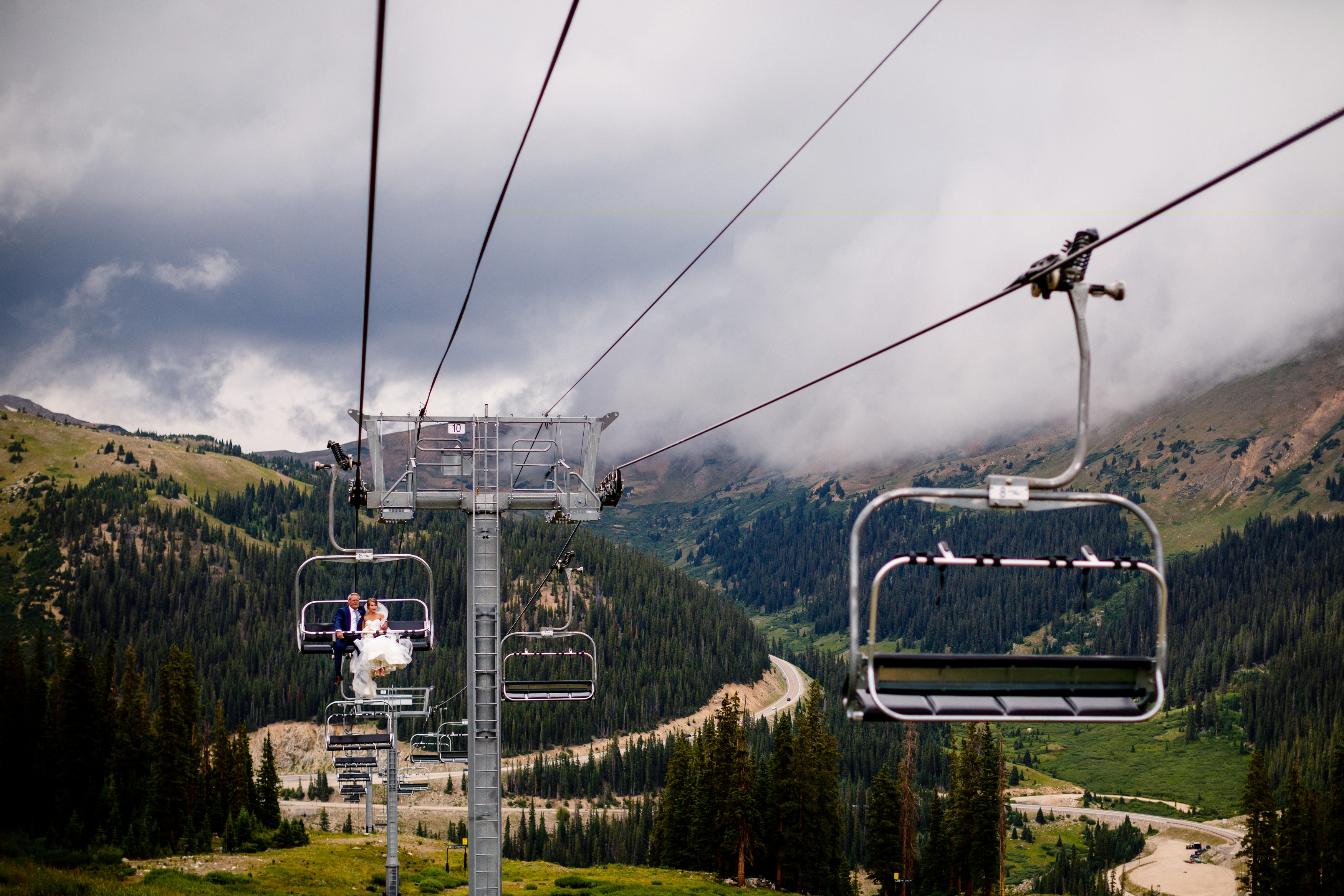 Riding up the chairlift at Arapahoe Basin before walking down the isle to get married at Black Mountain Lodge.