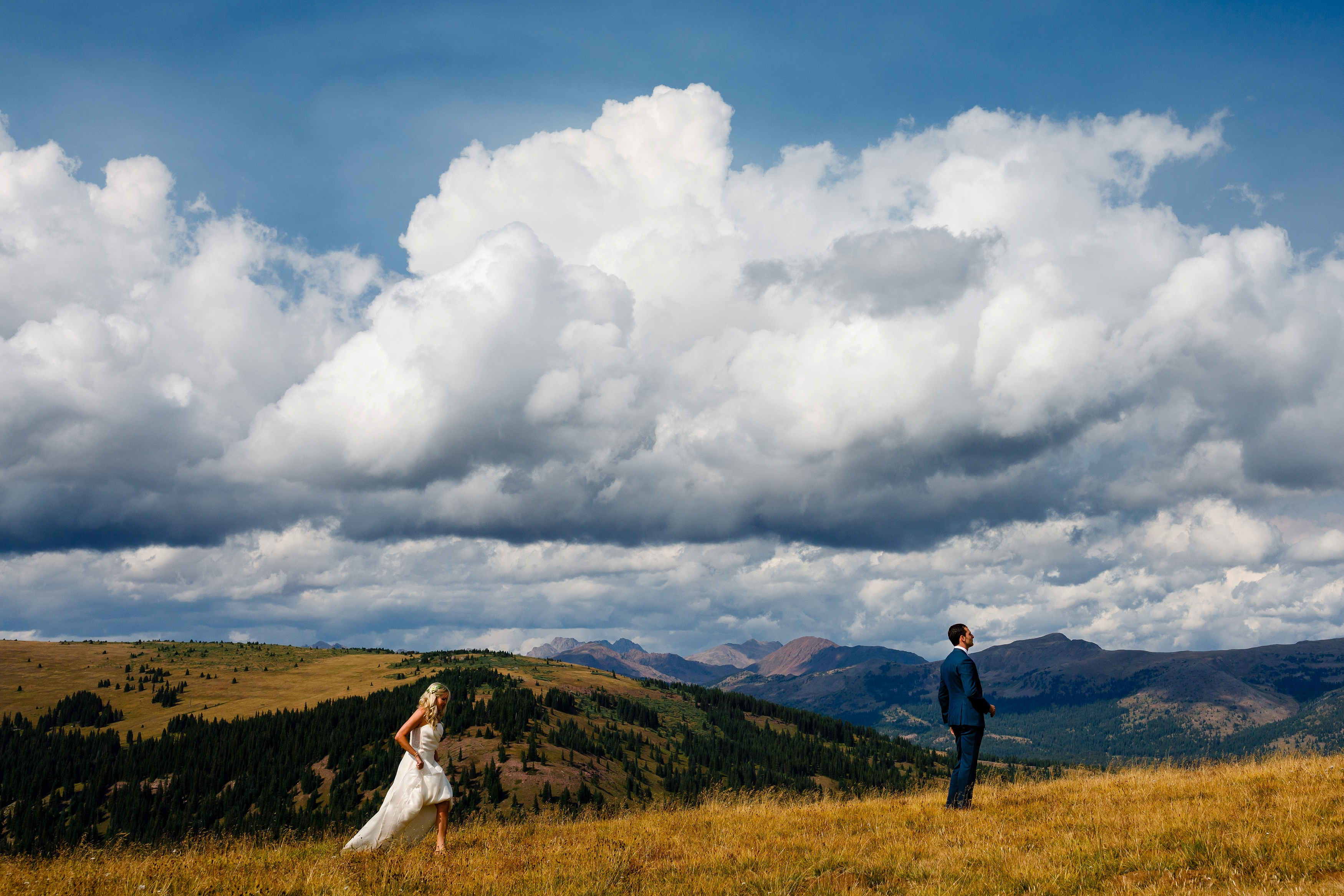The groom's first look at his beautiful bride on top of Ptarmigan Pass.
