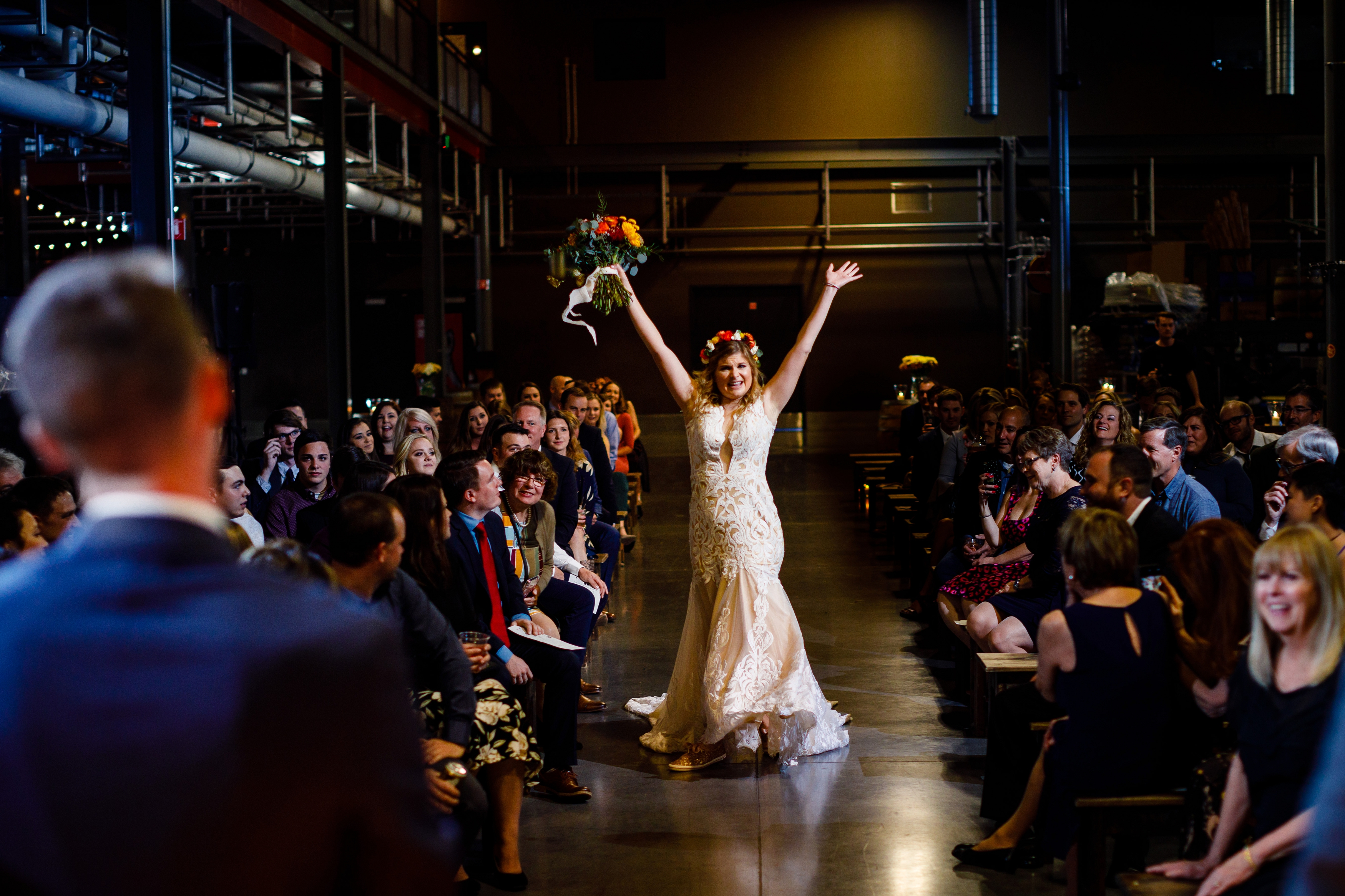 Jessica dancing down the isle before her & Jake's wedding ceremony at the Great Divide Barrel Bar.