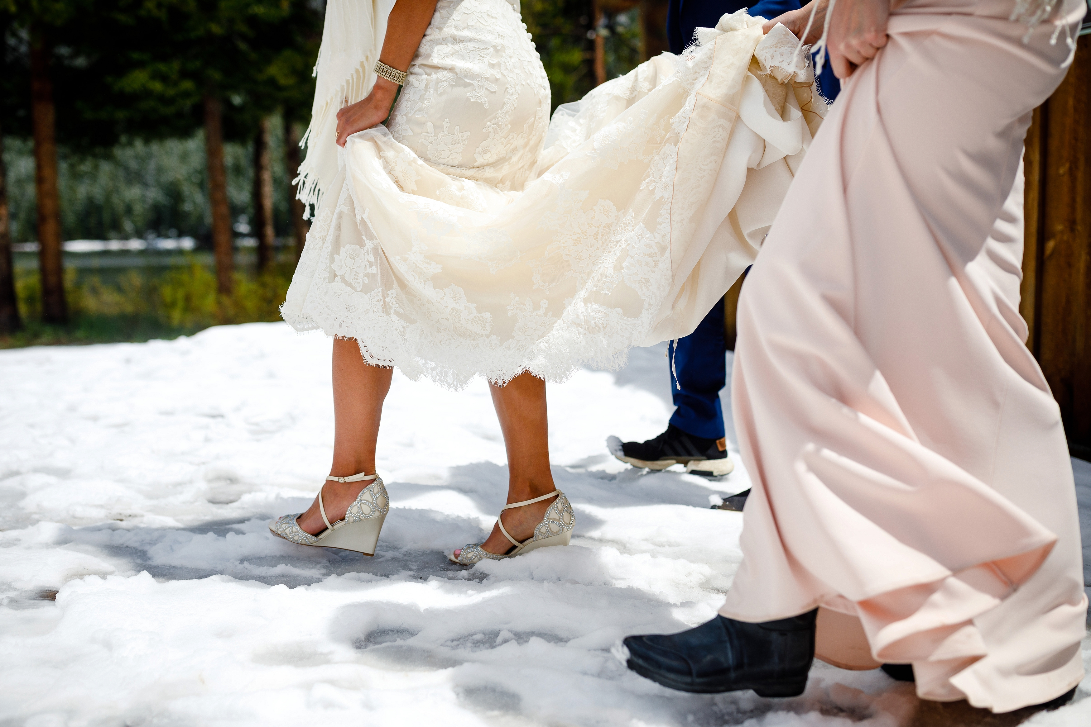 The bride walking through a few inches of snow as she heads to her first look at Piney.