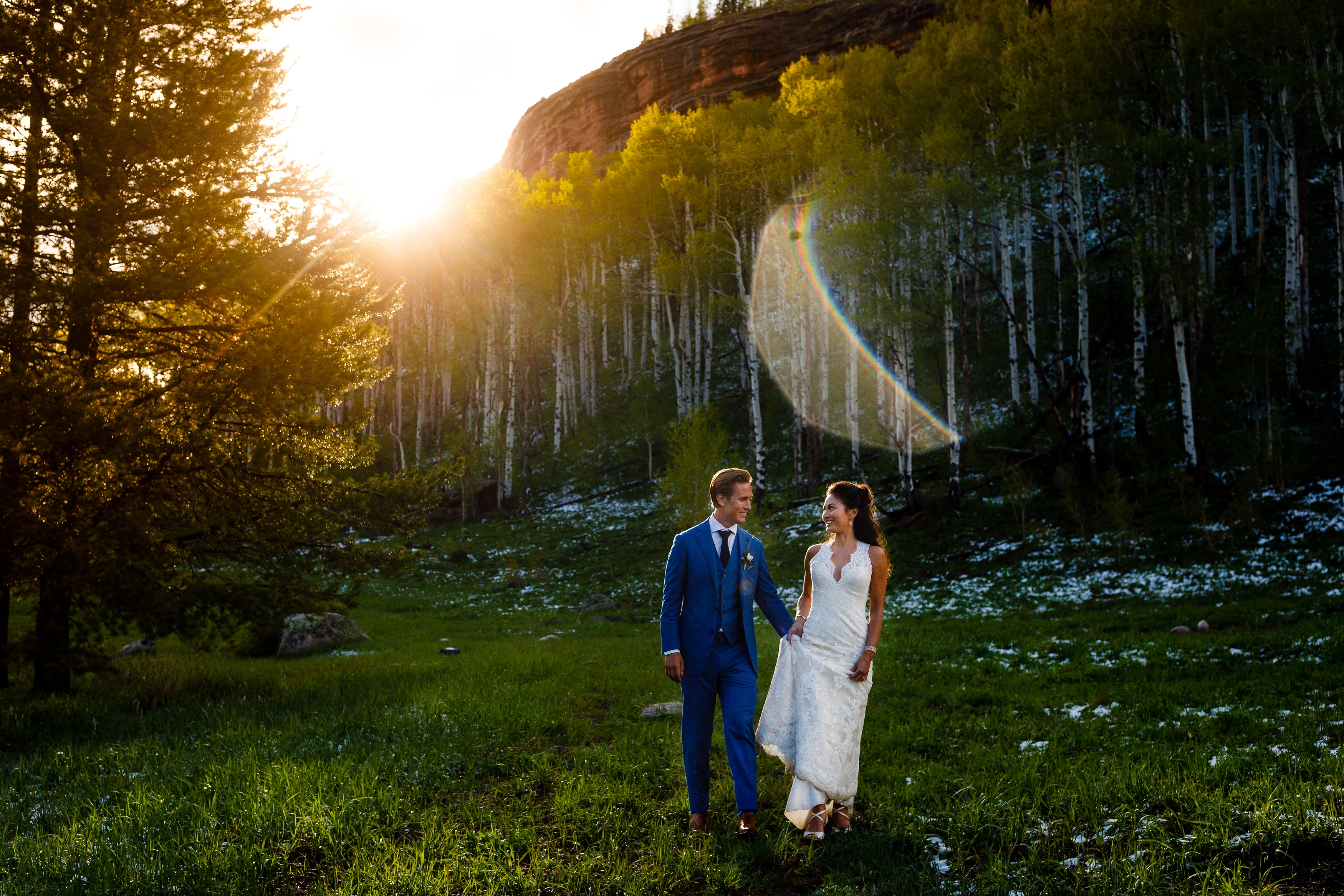 These two newlyweds take a stroll for the last bits of sunlight during their June wedding at Piney River Ranch just outside of Vail.