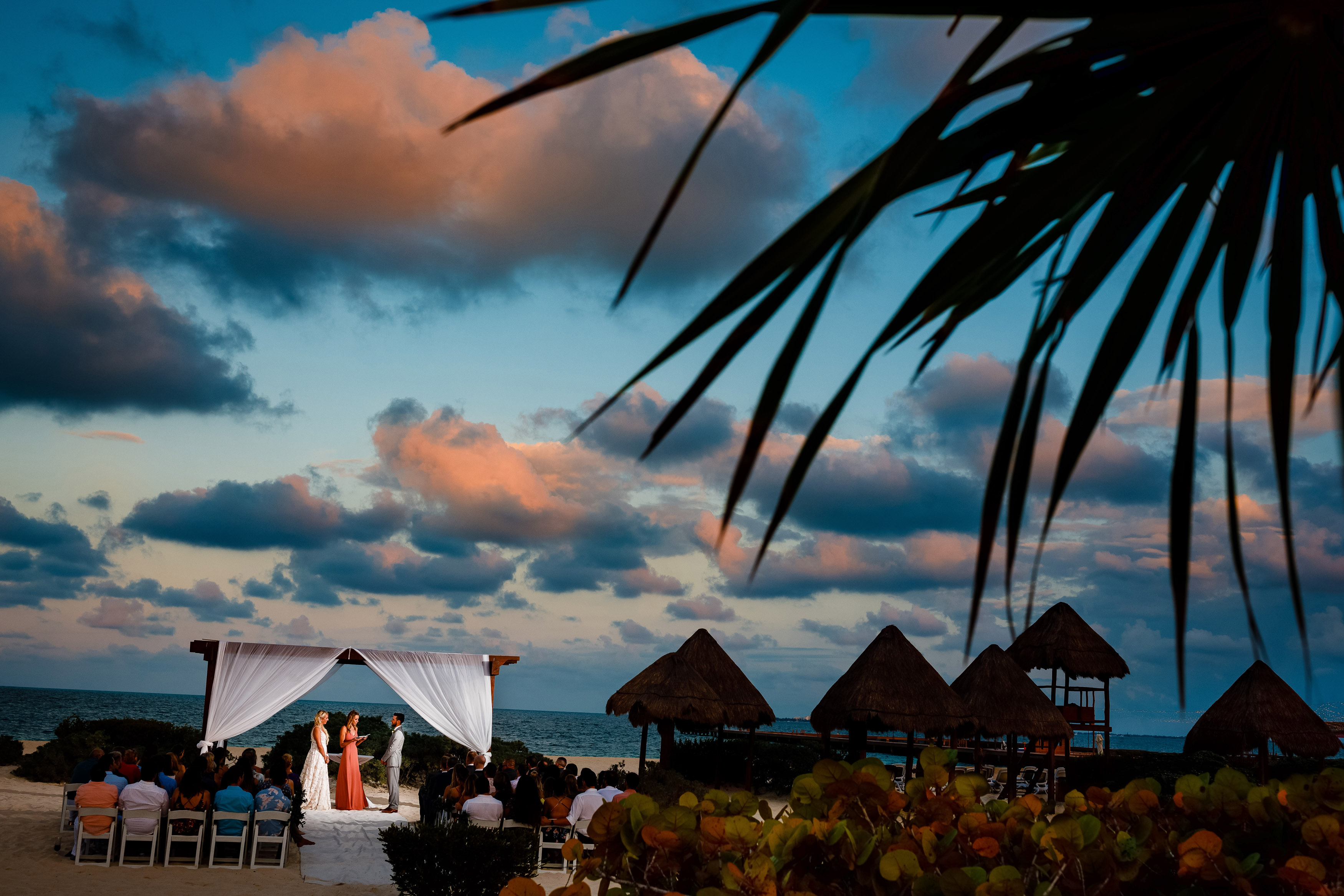 A sunset wedding ceremony at the Dreams Playa Mujeres Resort in Quintana Roo.
